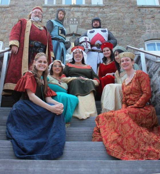 Museum employees all in medieval costumes