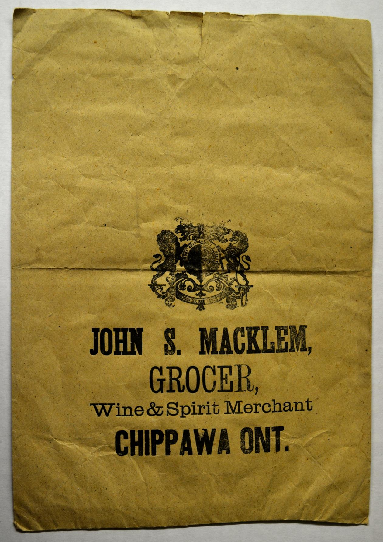 "Paper bag from John S. Macklem's store. Willoughby Historical Museum, W985.D.021.002b. Overlain is an advertisement printed in ""The Province of Ontario Gazetteer and Directory"" (1869). By this time, younger brother Thomas had joined him in business."