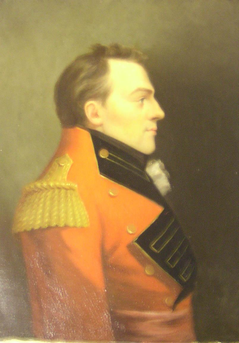 Oil Painting of Major-General  Sir Isaac Brock Brock in profile wearing his red tunic. He has a gold epaulette on his right shoulder, black collar and lapel, five godlen buttons to affix his tunic if deseired. Small puff of white fabric where his shirt ruffles portrude. He is slightly smiling.