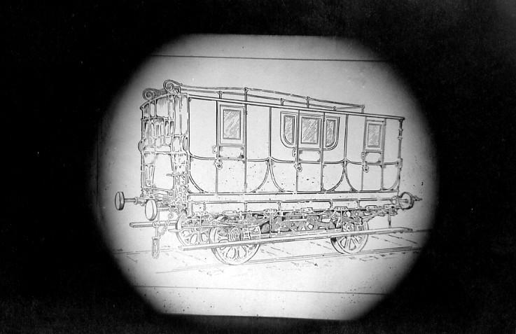 Image courtesy of the Niagara Falls (Ontario) Public Library Drawing of an ornate railway car which was used on the horse-drawn Chippawa-Queenston Railway. The car has three doors and five windows on near side, plus a short railing on the top of the car which might have been for luggage. Four wheels on a track and two bumpers at each the front and back of the car.