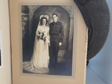 photograph of a couple who just got married with a cap drapped on the photo