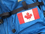 close up view of a blue back pack with a canada flag sew on