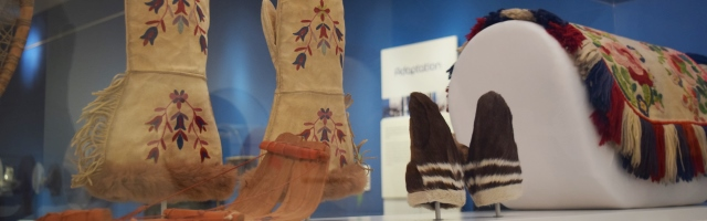 Mittens and a saddle cover on display in SNOW the exhibition