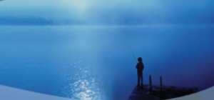 Title image for exhibition. Silhouette of a boy fishing on a dock.